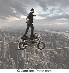 Businessman and acrobatic challenges - Concept of a business...
