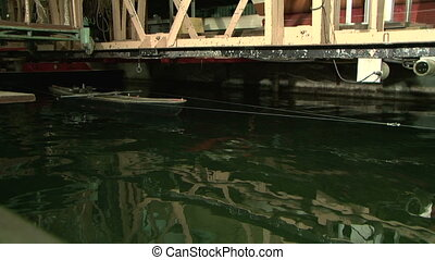 Testing the model of a ship in the pool. Check stability,...