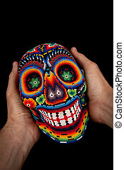 Smiling death at your hands - Colorful skull from mexican...