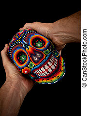 Beaded skull with hands Surprised - Colorful skull from...