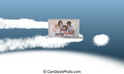 Video of happy family on a laptop - Animation of happy...