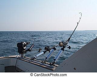 Three Fishing Poles Set Up For Trol - Three fishing poles...