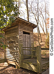 Old Outhouse - An old outhouse of wood behind a farm house...