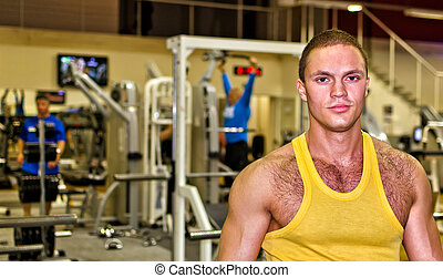 Portrait of handsome bodybuilder in fitness club