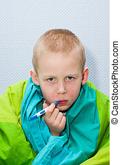 Sick boy - A sick little boy is measuring the temperature...