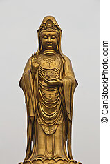 Guan Yin Statue wonderful - Oriental Buddha Statue, against...