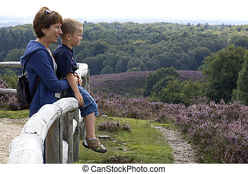 Grandma and grandson looking at a beautiful landscape.