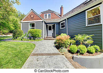 Blue grey house exterior with green landscape. - Blue grey...
