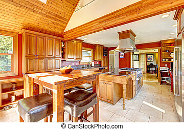 Red large luxury kitchen interior with beautiful wood.