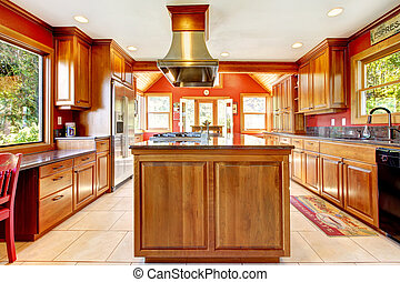 Large red luxury kitchen with wood and tiles.