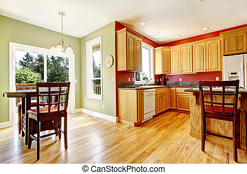 Yellow kitchen with wood and red and green colors.