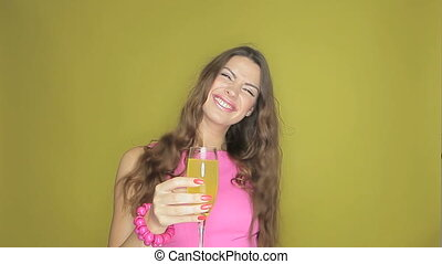 Happy woman partying with a drink in her hand