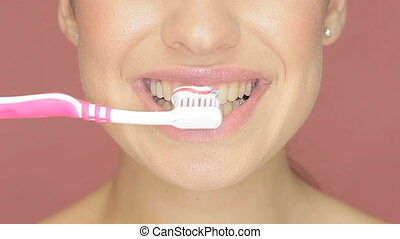 Smiling woman with toothbrush - Closeup cropped view of the...
