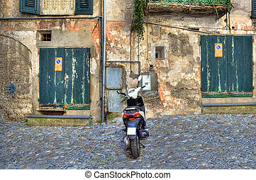 Traditional old backyard Ventimiglia, Italy - Scooter on...