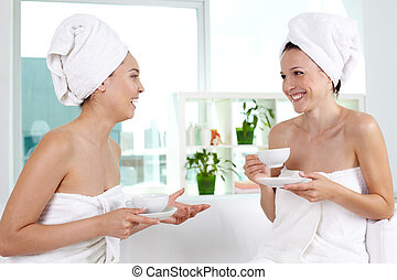 Happy friends - Girls in bath towels laughing together in...