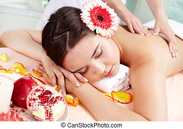 Vital energy - Massage therapist helping young woman...