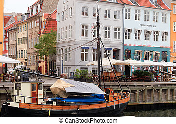 Nyhavn boats - Old sail boat on a canal at Nyhavn...