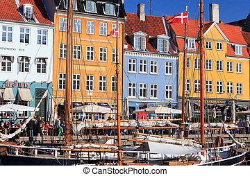 Nyhavn Copenhagen - Tourists in colourful Nyhavn Copenhagen...