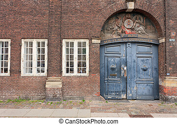 Old Danish door - Blue wooden door and brick arch in...