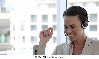 Business woman laughing while talki