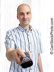 young man with a TV remote