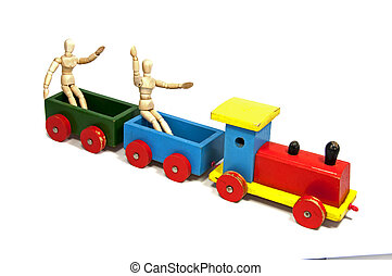 two wooden dolls sitting on a train