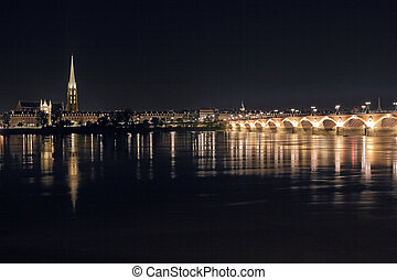Night panorama of Bordeaux. View from behind river to The...