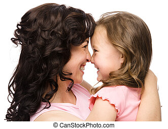 Portrait of happy daughter smiling at her mother