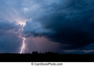 Lightning 005 - A bolt of lightning streaks down from a...