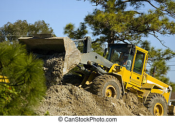 Front-end loader at work - A Front-end loader at work...