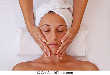 face massage - woman getting relaxing head or face massage