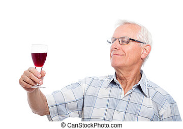 Senior man tasting wine - Happy senior man tasting wine,...
