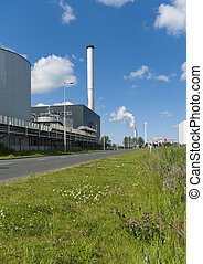 industrial building - factory with large chimney in...