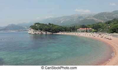 Pink sandy Milocher Beach. Montenegro, 6 kilometers...
