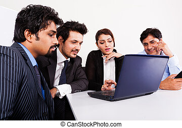 group of multi racial business people in meeting, Inidan...