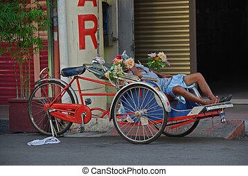 Trishaw B - Trishaw parked on a street