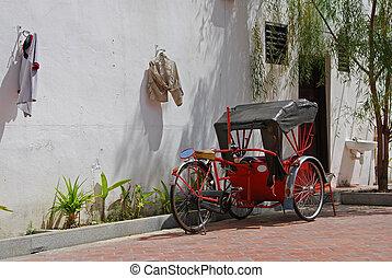 Trishaw C - Trishaw parked on a street under a tree