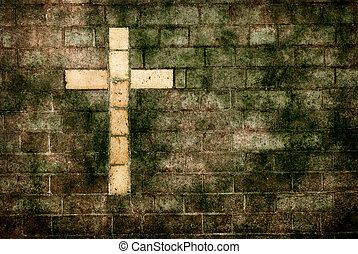 cross of christ built into a brick wall - grungy cross of...