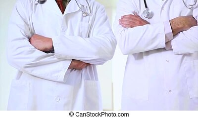 Two doctors standing in a hospital