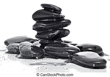 balanced black zen stones - a pile of balanced zen stones...