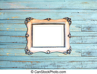 Silver Vintage picture frame on blue wood background -...