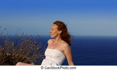 happy redhead woman feeling wind
