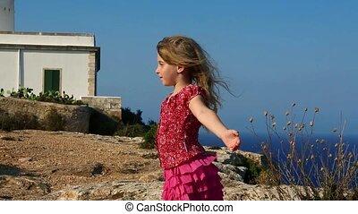 happy little blond girl feel wind - happy little blond girl...