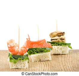 Set of tasty canape from seafood