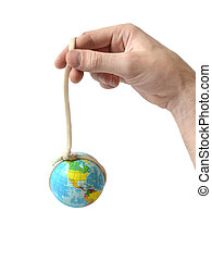 hand holding the globe adhered by a rope