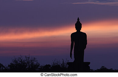 Silhouette of Buddha and the blue sky