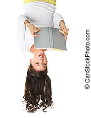 Exciting plot - Surprised teen reading book in an unusual...