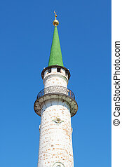 Minaret Muslim mosque towering against the blue sky