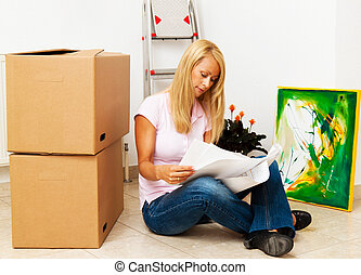 woman with new housing plan - woman with boxes to move into...