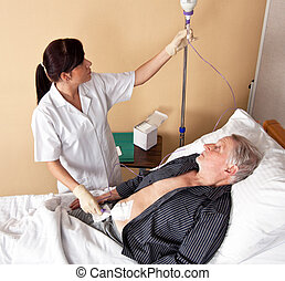 nurse gives a patient a infusio - a nurse gives a patient an...